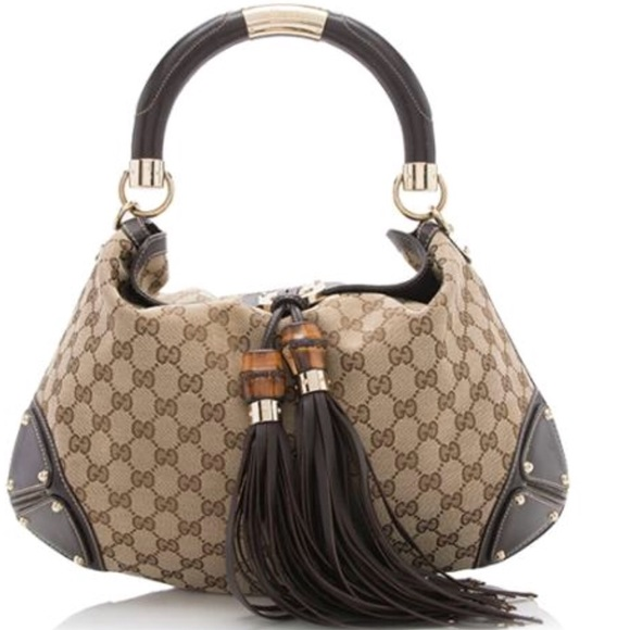 5a4f0c162a3 Gucci Handbags - Tan   Brown Gucci GG canvas Indy (medium) satchel